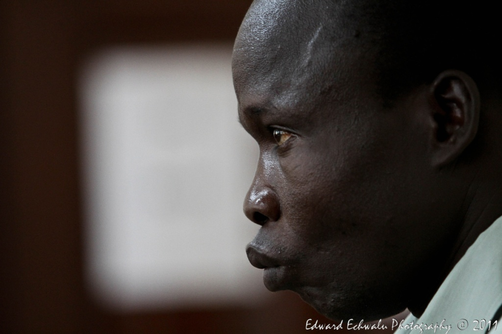 Thomas Kwoyelo, a former director of field operations in the rebel group LRA appears before a War Crimes Court in Gulu, 300km (217 miles) north of Uganda's capital, Kampala on July 25, 2011. Kwoyelo is presently facing 53 charges of war crimes comprising murder, kidnap with intent to murder among others. Uganda becomes, the first African Country to try nationally those alleged to have committed war crimes and crimes against humanity.