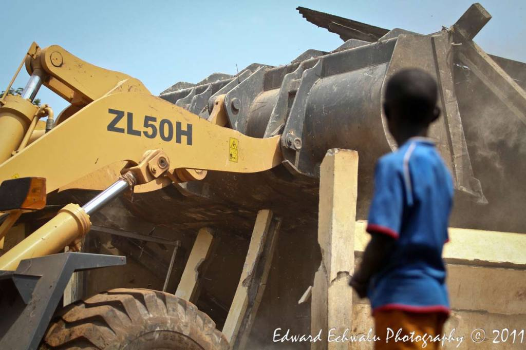 HELPLESS: A boy helpless watch their house being erased by a grader on July 4, 2011.He, like a host of other children did not go to school in preparation for the event that they are evicted. The eviction, Kampala City Council Authority (KCCA) says will pave way for the redevelopment of the area (Naguru/Nakawa estates) into a modern Satelite town.