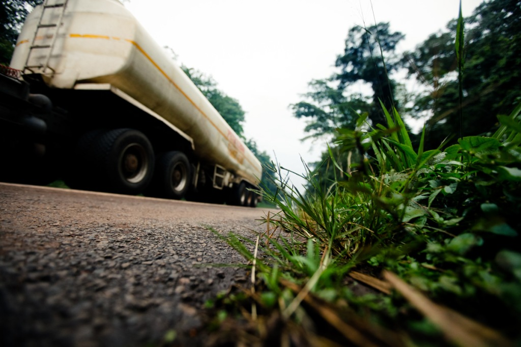 .A fuel tank is seen along the Kampala-Jinja Highway inside Mabira Forest.  President Yoweri Museveni recently proposed that over 7,100 hectares of part of Mabira reserve forest be given to Methta group of companies for Sugar cane plantation.