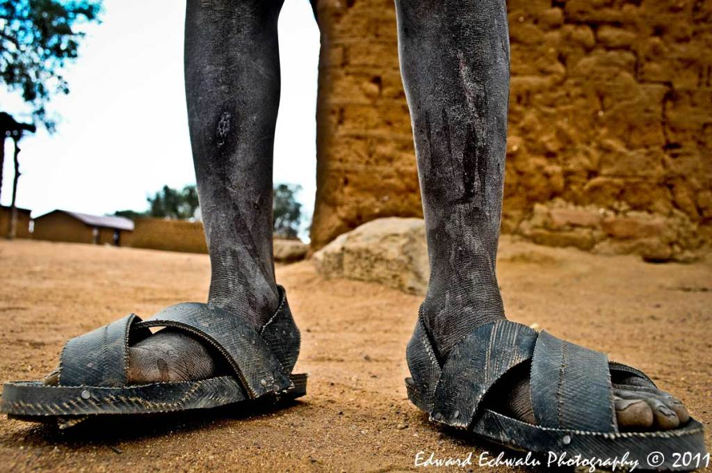 "KARAMOJA: A lovely foot of a boy in Moroto district, north of Uganda's capital, Kampala. I love the shoes. They are popularly known as ""Lugabire"" in the greater north and is believed to be an original creation of the Karimojong, a popular pastoral tribe in Northern Uganda."