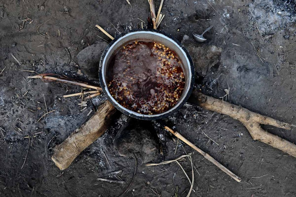 DINNER: Boiling beans for dinner in Karamoja. Most of these are handouts by UN agencies as the unreliability of rains in the region has rendered the practice of agriculture dormant.