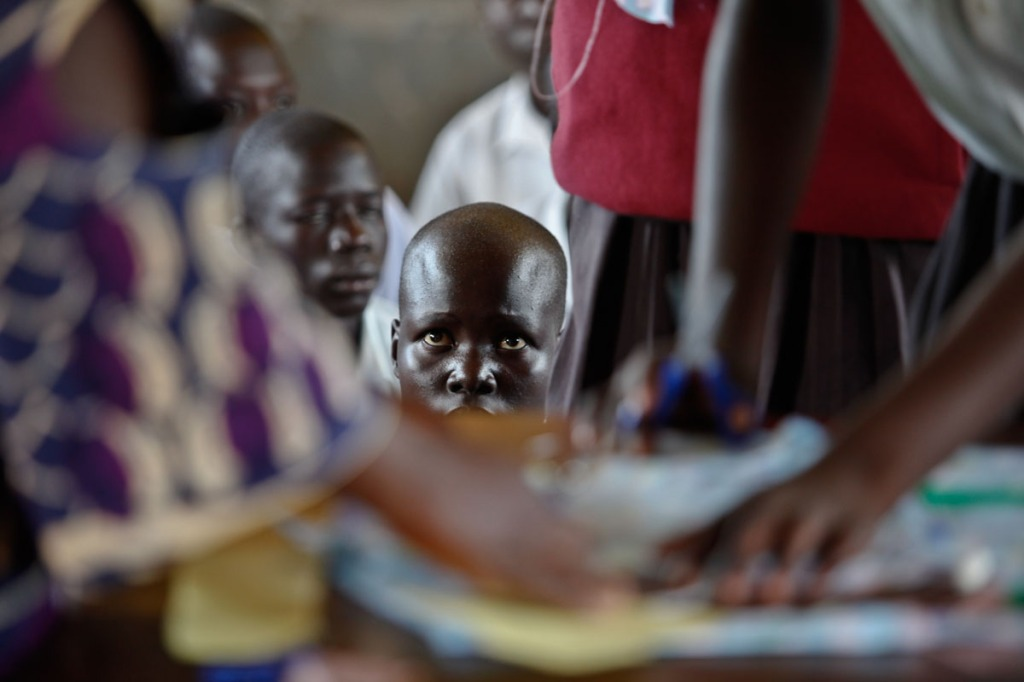 A girl pays attention during a hands-on practical class of making sanitary pads. Awere Primary school, 80km northeast of Gulu town started the project of hand making sanitary pads to keep girls at school.