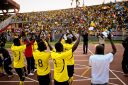 Uganda Cranes players applaud the thousands of Ugandan supporters who travelled to Nairobi for the game against Kenya on 10/9/2010