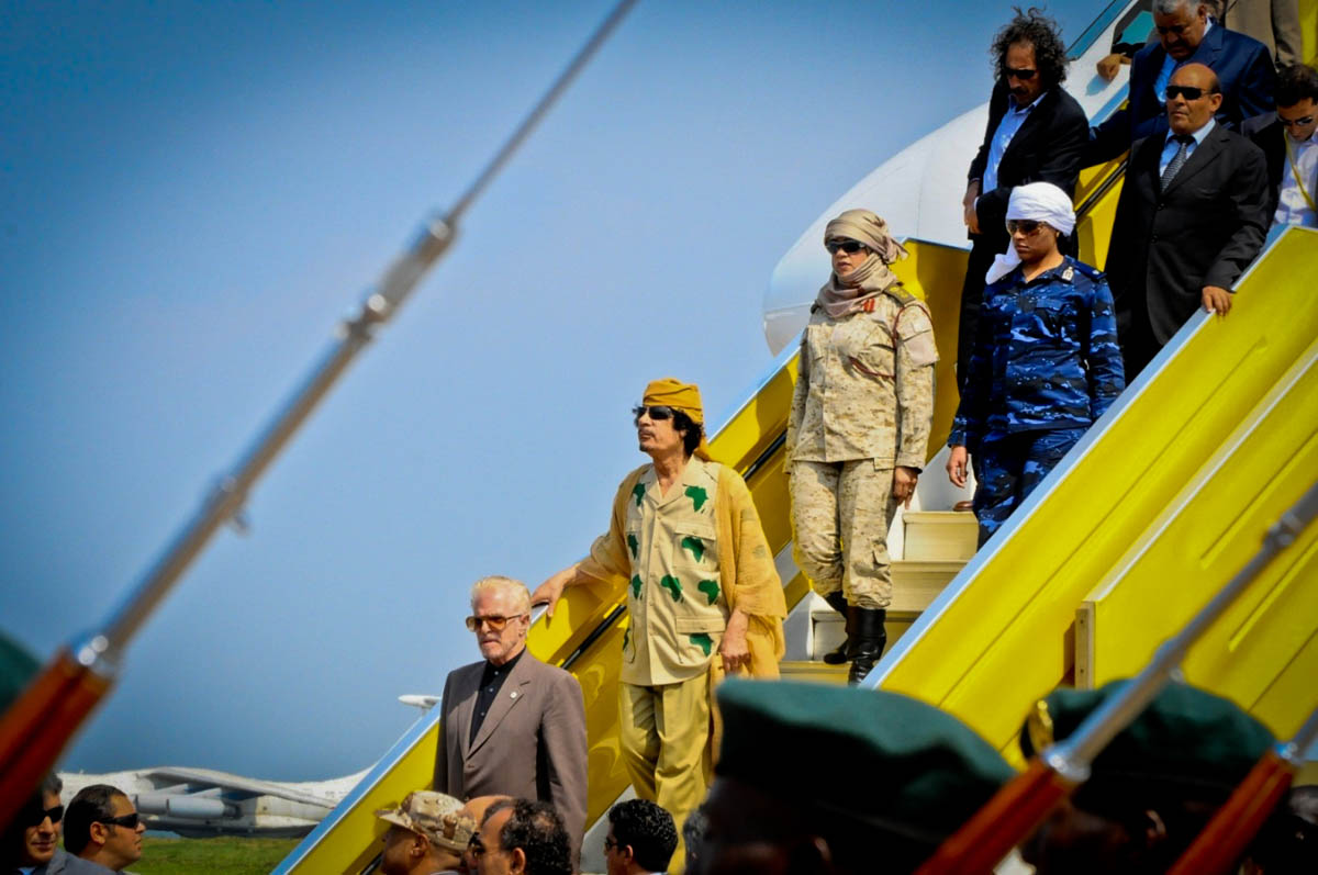 "Muammar Gaddafi arrives at the Entebbe International Airport for the 2010 AU Summit in Kampala. It happened to be his last visit to Uganda after being killed by Libyan forces with support from NATO.  ""We announce to the world that Gaddafi has been killed at the hands of the revolution,"" National Transitional Council (NTC) spokesman Abdel Hafez Ghoga said on Thursday in the eastern city of Benghazi."