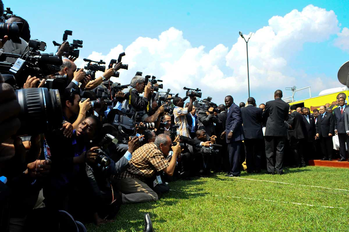 "Muammar Gaddafi always attracted a huge media following wherever he went. Here, photographers/Video journalists struggle to capture a group picture of the African heads of states, Gaddafi inclusive after the opening ceremony of the 2010 AU Summit at the Munyonyo Commonwealth Resort Hotel on August 25, 2010. It happened to be Gaddafi's last visit to Uganda after being killed by Libyan forces with support from NATO.  ""We announce to the world that Gaddafi has been killed at the hands of the revolution,"" National Transitional Council (NTC) spokesman Abdel Hafez Ghoga said on Thursday in the eastern city of Benghazi."
