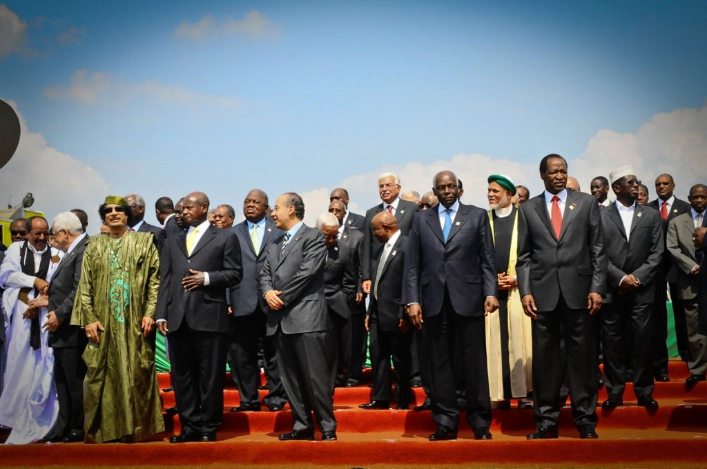 "Muammar Gaddafi (3rd from left in green ) stands for a group picture after the opening ceremony of the 2010 AU Summit at the Munyonyo Commonwealth Resort Hotel on August 25, 2010. It happened to be Gaddafi's last visit to Uganda after being killed by Libyan forces with support from NATO.  ""We announce to the world that Gaddafi has been killed at the hands of the revolution,"" National Transitional Council (NTC) spokesman Abdel Hafez Ghoga said on Thursday in the eastern city of Benghazi."