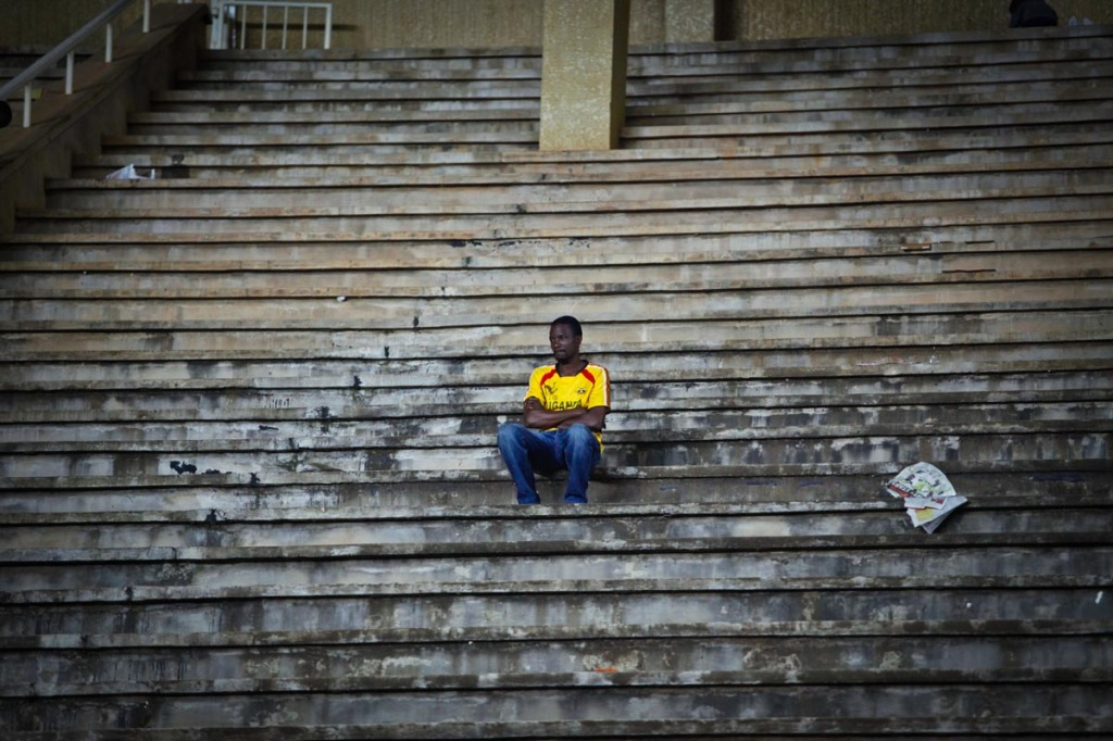 HEART BROKEN: A fan remains seated at Namboole Stadium long after the final whistle which condemned Uganda Cranes to another 35 year wait had gone. Vuvuzela's went silent, Voices compressed to whispers, and lots of people trekked long journeys back home with their necks at an angle low with shrugging shoulders. This was not how it was meant to end.