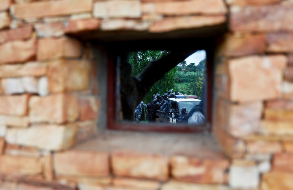 Police is seen deployed infront of Ugandan opposition leader, Kizza Besigye's house in Kasangati,a suburb of Kampala's capital on  October 19, 2011