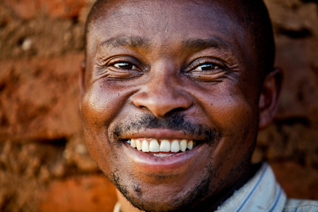 Ivan strikes a happy face at his home in Kasese. He's among the small scale farmers benefitting from the Swedish Cooperative Centre.